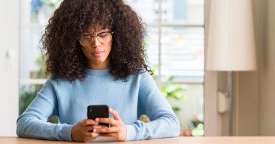 black woman, phone, friends