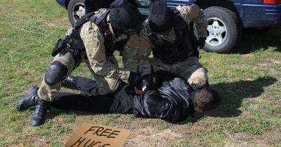 cops, police, military police, camo, free hugs, creepy, guy, violence, protest