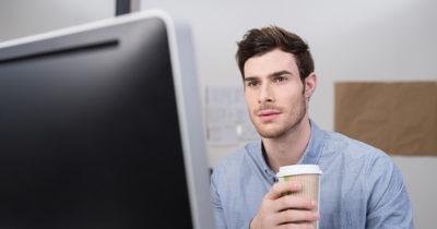 intern, piss, computer, white guy, facial hair, short hair, blue shirt, latte, cup, starbucks, coffee
