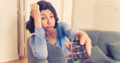 tv remote, watch, woman, blue shirt, v-neck, bored, brunette, sad, couch, lazy, quarantine