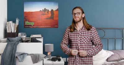 long hair, glasses, sleep poster, blue room, pot, pothead, messy, messy room, gross, disorderly, late