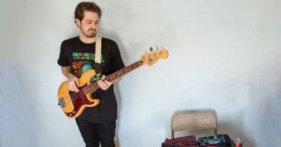 bassist, merch, sell, play, rhythm, sad, travesty, depressing, loser, demotion, job, band, member, math, calculate, stoner, loser, weirdo